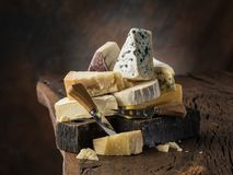 Assortment of different cheese types on wooden background. Cheese background.  royalty free stock photography