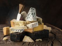 Assortment of different cheese types on wooden background. Cheese background.  stock image