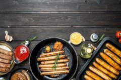 Assortment of different fried sausages with sauces stock photography
