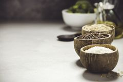 Assortment of different rice in bowls Royalty Free Stock Photography