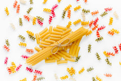 Assortment of different shape italian pastas on white background top view Royalty Free Stock Photos