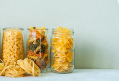 Assortment of different shapes whole grain raw Italian pasta in Stock Image
