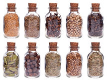 Assortment of different spices in glass bottles Stock Photos