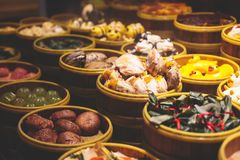 Assortment of different types of asian traditional street food in Shanghai street, China. Assortment of different types of asian traditional street food in Royalty Free Stock Images