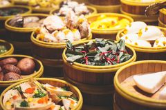 Assortment of different types of asian traditional street food in Shangha streeti, China. Assortment of different types of asian traditional street food in Stock Photos