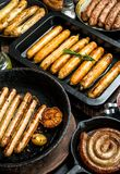 Assortment of different types of fried sausages stock image