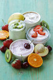 Assortment of different yogurt for breakfast with berries Stock Photo