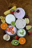 Assortment of different yogurt for breakfast with berries  Royalty Free Stock Images
