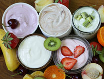 Assortment of different yogurt for breakfast with berries Royalty Free Stock Photo