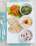 Assortment of dips: hummus, chickpea dip, tabbouleh salad, baba ganoush and flat bread, pita Stock Images