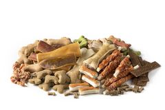 Assortment of dog snacks. Isolated on a white background Royalty Free Stock Photo