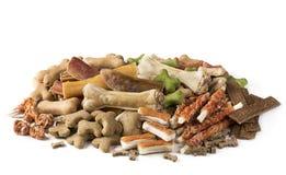 Assortment of dog snacks. On a white background Stock Photo