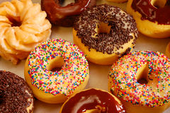 Assortment of donuts. With colorful sprinkles and icing Stock Photos