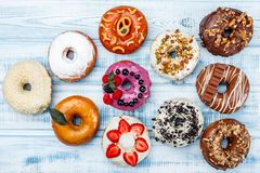 Assortment of donuts for any taste, on old wood background stock photos