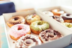 Assortment of donuts in a delivery box Royalty Free Stock Image