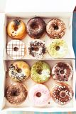 Assortment of donuts in a delivery box Royalty Free Stock Photography