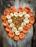 Assortment of dried figs, raisins and apricots in the form of heart. Stock Photography