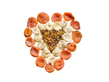 Assortment of dried figs, raisins and apricots in the form of heart isolated on white background Stock Images