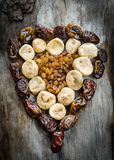 Assortment of dried figs, raisins and dates in the form of heart. Stock Images