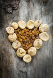 Assortment of dried figs and raisins in the form of heart. Royalty Free Stock Image