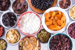 Assortment of dried fruit in individual dishes Stock Images