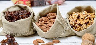Assortment of dried fruit in small bags canvas Royalty Free Stock Photo
