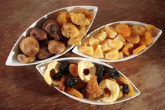 Assortment of dried fruits. On wooden surface Stock Photography