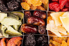 Assortment of dried fruits closeup background in square cells. Stock Image