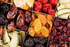 Assortment of dried fruits closeup background in square cells. Royalty Free Stock Image