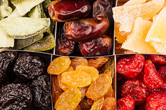 Assortment of dried fruits closeup background in square cells. Stock Photos