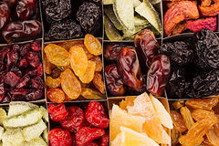 Assortment of dried fruits closeup background in square cells. Royalty Free Stock Photography