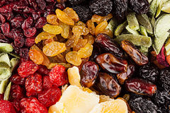 Assortment of dried fruits closeup background in square cells. Stock Images