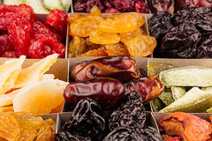 Assortment of dried fruits closeup background in square cells. Royalty Free Stock Images