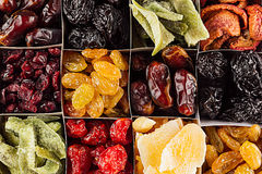 Assortment of dried fruits closeup background in square cells. Decorative pattern of dry exotic fruit. Royalty Free Stock Photos