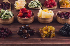 Assortment of dried fruits closeup on brown wooden background. Royalty Free Stock Photos