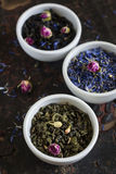 Assortment of dried tea in white bowls Royalty Free Stock Photos