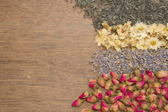 Assortment of dried tea on wooden background Royalty Free Stock Photo