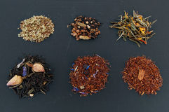 Assortment of dried teas on dark background Royalty Free Stock Photo