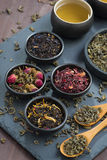 Assortment of dry tea in bowls, top view Stock Image