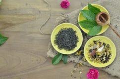 Assortment of dry tea and fresh tea leaves on wooden background. Assortment of dry tea and fresh tea leaves on wooden table Royalty Free Stock Photography