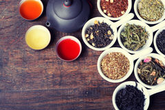 Assortment of dry tea. On wooden background Stock Images