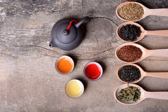 Assortment of dry tea. On wooden background Stock Image