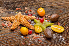 Assortment of exotic fruits, nuts and starfish Royalty Free Stock Photos