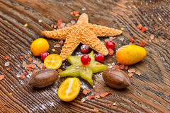 Assortment of exotic fruits, nuts and starfish Stock Photo