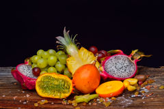 Assortment of exotic fruits on a wooden background Royalty Free Stock Image