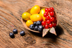 Assortment of exotic fruits on a wooden background Royalty Free Stock Photography