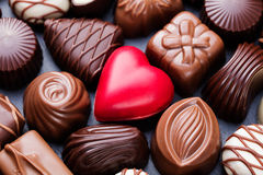 Assortment of fine chocolate candies, white, dark, and milk chocolate Sweets background Stock Photos