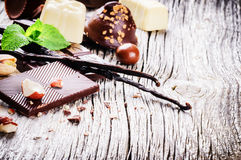 Assortment of fine chocolates and pralines with fresh mint and v Royalty Free Stock Images