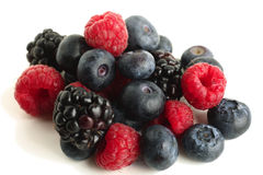 Assortment of forest fruits. An assortment of forest fruits, rasperries, blueberries and blackberries Stock Images