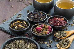 Assortment of fragrant dried teas and green tea, close-up. Horizontal Stock Photography
